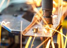 Spot welding machine, automotive part in a car factory